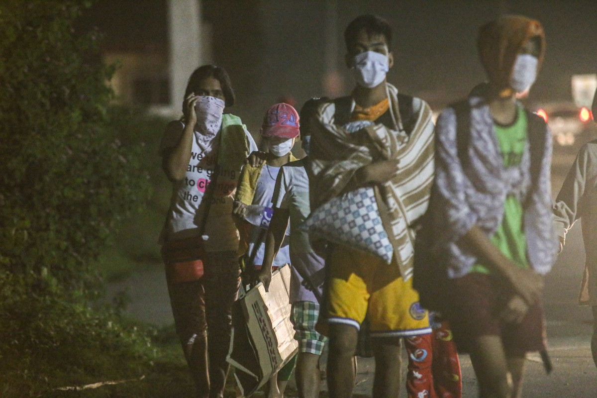 People leaving their homes after Taal volcano eruption