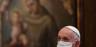 Pope Francis wearing white mask