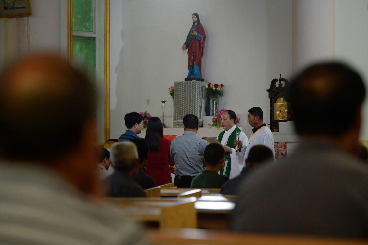 Chinese Catholics in underground church