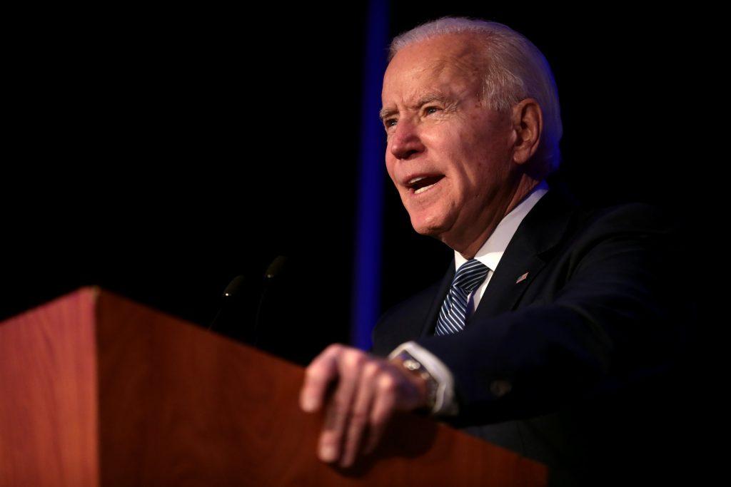 Joe Biden addressing audience from a lectern | Licas News