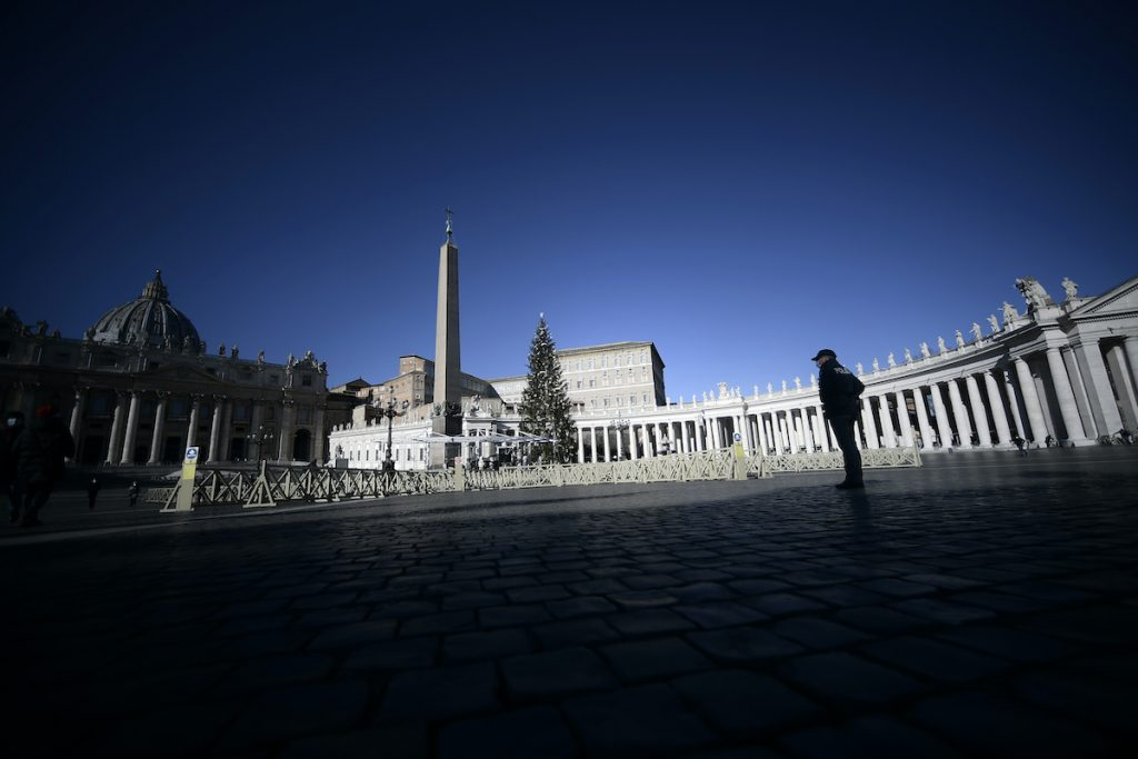 Lone policeman in an empty St. Peter's Square