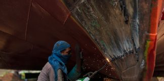 Worker breaking up a ship in Dhaka