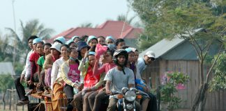 Garment workers on overloaded motor-rickshaw
