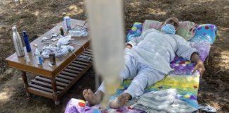 Indian man lying under a Neem Tree