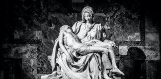 """La Pieta (""""The Pity"""") 1499 Renaissance sculpture by Michelangelo di Lodovico Buonarroti Simoni, inside St. Peter's Basilica"""