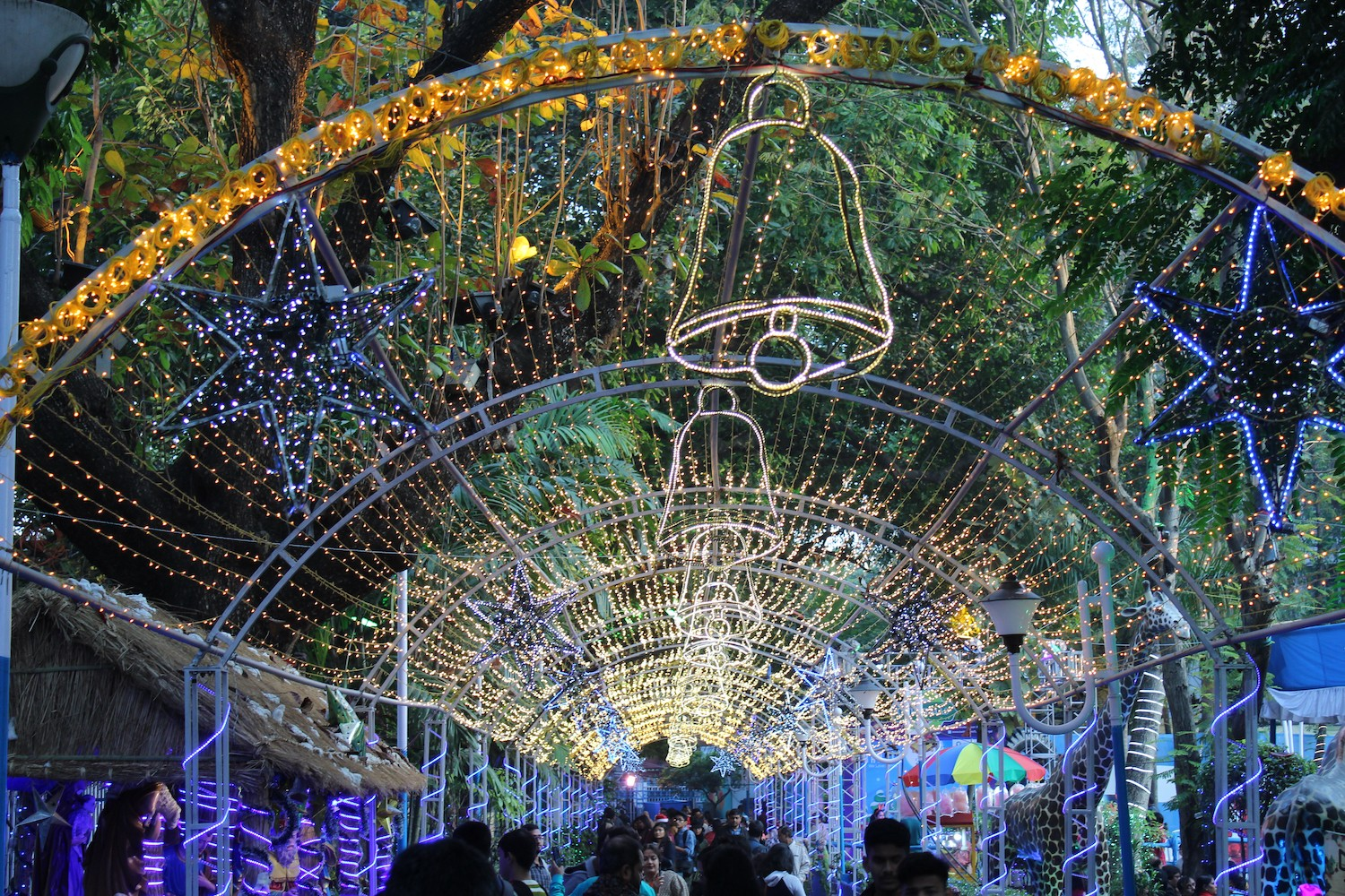 Christmas decorations on a street in Kolkata with crowd